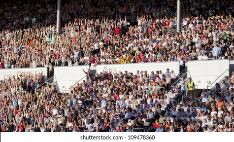 HELSINKI,FINLAND-JULY 31:Unidentified fans at gig of Bruce Springsteen & the E Street Band performing live on stage on Wrecking Ball Tour July 31,2012 at Helsinki Olympic Stadium, in Helsinki,Finland.