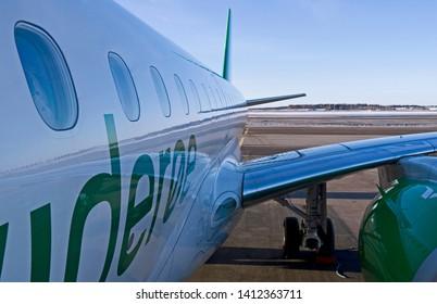 Helsinki-Vantaa / Finland / February, 17th 2019: A new Embraer E190-E2 of Norwegian Widerøe's Flyveselskap on the apron of Vantaa airport