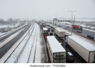 HEMEL HEMPSTEAD, UK - DECEMBER 10, 2017: Traffic jam on the British motorway M1 during the snowstorm.