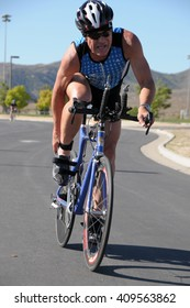 Hemet, California/USA-April 17 2016:Athlete on bike in the Diamond Valley Triathlon