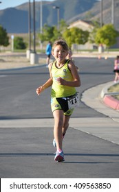 Hemet, California/USA-April 17 2016:Athlete running in the Diamond Valley Triathlon