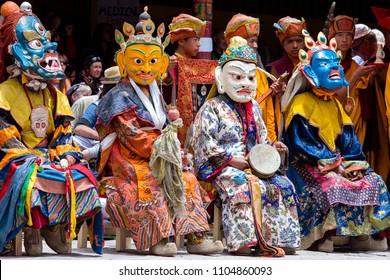 HEMIS, INDIA - JUNE 26, 2015 : Tibetan buddhist lamas dressed in mystical mask dance Tsam mystery in time of Hemis Tse Chu festival, Ladakh, North India
