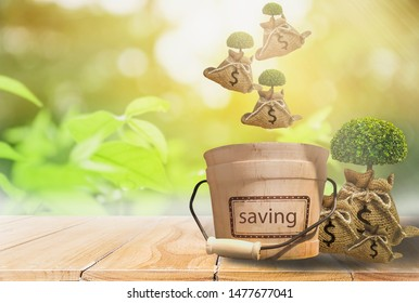 Hemp bag with dollar sign and growing tree with dropping from top,Into wooden bucket,concept of saving money,investment and financial planning,deposit in bank,for future stability with copy space