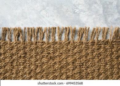 Hemp carpet on Cement floor. Sisal background or wallpaper.