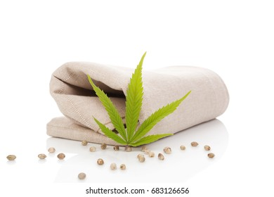 Hemp cloth production, cloth with cannabis leaf and seeds, isolated on white background.
