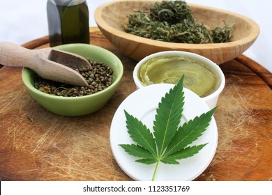 Hemp cosmetic and medicine healthy products, ointment, leaf, dry marijuana and cannabis oil.