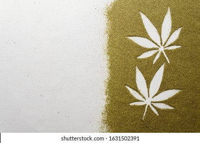 Hemp flour concept, top view. Scattered hemp flour on a light concrete surface. The image contains copy space, the shape of hemp leaves made of flour, horizontal orientation.