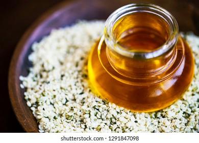Hemp oil with hemp seeds, CBD oil extract from hemp plant, pure terapeutic medicinal oil