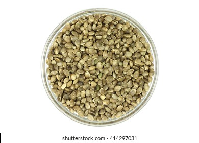 hemp seed in a glass cup on a white background