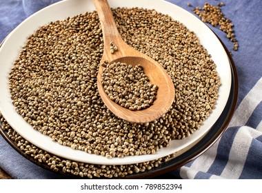Hemp seeds on wooden table.  Flat lay.