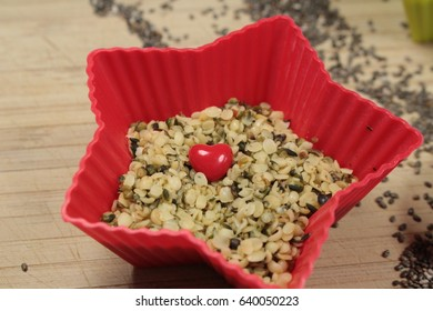 Hemp seeds/This is a hemp seeds  in red star bowls.