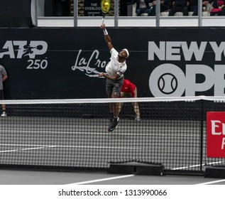 Hempstead, NY - February 14, 2019: Frances Tiafoe serves during round of 16 match against Jason Jung of Taipei at ATP 250 New York Open 2019 tennis tournament at Nassau Coliseum, Jung won match