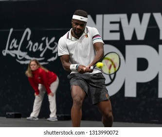 Hempstead, NY - February 14, 2019: Frances Tiafoe returns ball during round of 16 match against Jason Jung of Taipei at ATP 250 New York Open 2019 tennis tournament at Nassau Coliseum, Jung won match