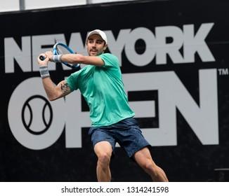 Hempstead, NY - February 15, 2019: Jordan Thompson of Australia returns ball during quarterfinal match against John Isner of USA at ATP 250 New York Open 2019 tennis tournament at Nassau Coliseum