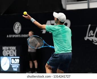 Hempstead, NY - February 15, 2019: Jordan Thompson of Australia serves during quarterfinal match against John Isner of USA at ATP 250 New York Open 2019 tennis tournament at Nassau Coliseum