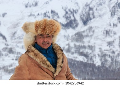 Hemu, Xinjiang - February 16, 2018: Tuva man competing in a horse race competition in the Altai mountains in China