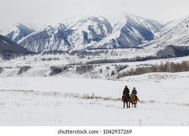 Hemu, Xinjiang - February 16, 2018: Tuva men competing in a horse racing competition in the Altai mountains in China