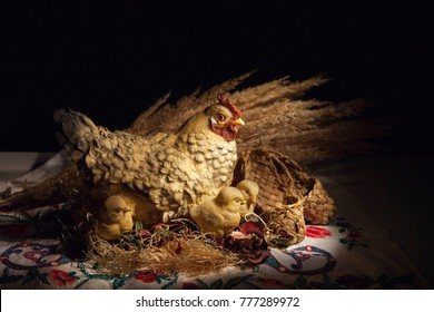 hen figurine with chickens under wings