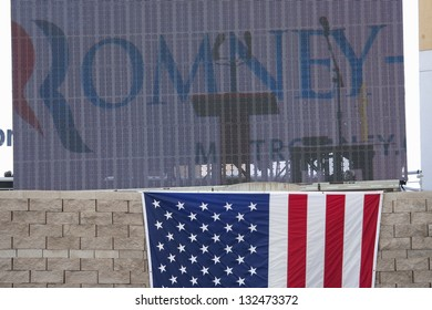 HENDERSON, NV - OCTOBER 23: US Flag under the sign for Governor Mitt Romney at the 2012 Republican Presidential Candidate ON October 23, 2012 in Henderson Pavilion, Henderson, Nevada.
