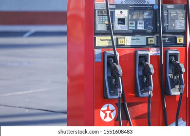 Henderson, NV, USA 11/5/2019 — An older model fuel pump from the 2000's with three hoses for each gas octane grade: 87, 89, and 91. Taken at a Texaco franchised by Terrible Herbst in Southern Nevada.