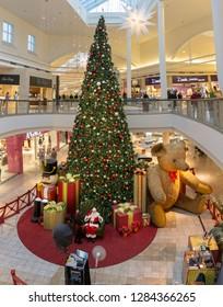 Henderson, NV, USA - Dec 06-2018 - Santa Claus at the foot of a huge Christmas tree at the shopping mall, Galleria at Sunset, Las Vegas.