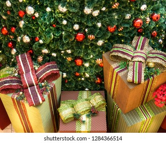 Henderson, NV / USA - Dec 06-2018 - Christmas presents at the foot of a huge Christmas tree at the shopping mall Galleria at Sunset, Las Vegas.