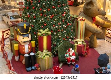 Henderson, NV /  USA - Dec 06-2018 - Photo shoot of Santa Claus at the foot of a huge Christmas tree at the shopping mall Galleria at Sunset, Las Vegas.