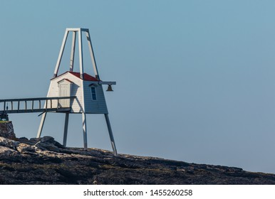 Hendricks Head Lighthouse hut in Southport, Maine marks the west side of the Sheepscot River, on a summer morning from kayak pov