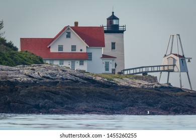 Hendricks Head Lighthouse in Southport, Maine marks the west side of the Sheepscot River, on a summer morning from kayak pov