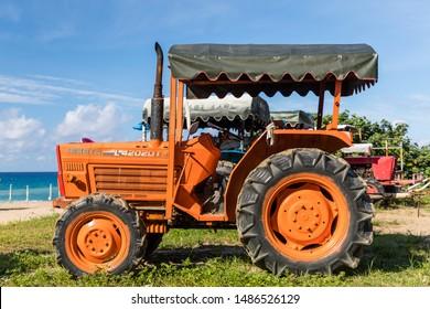 Hengchun, Pingtung County, Taiwan - 19 June 2019: An old and rusty KUBOTA L4202 DT Tractor for maintenance and raking of Chuan Fan Shi Public Beach