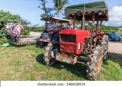 Hengchun, Pingtung County, Taiwan - 19 June 2019: An old and rusty Kubota 5000 DT Tractor for maintenance and raking of Chuan Fan Shi Public Beach