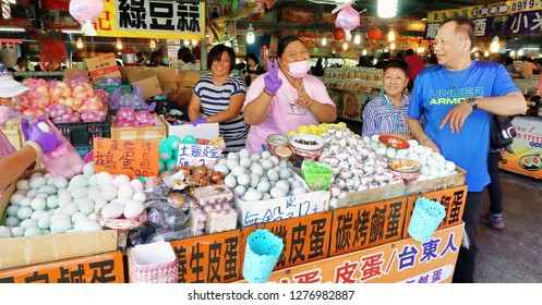 Hengchun,Taiwan - Dec.8, 2018 - Busy food court in Hengchun, Taiwan with busy egg lady selling fresh eggs.