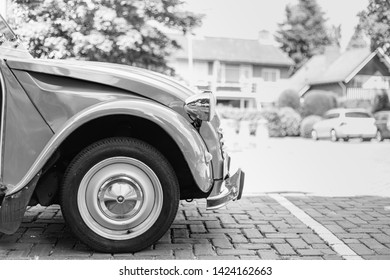 Hengelo / Netherland - June 11 2019 : black and white photo of the front side of a car, a Citroën 2cv
