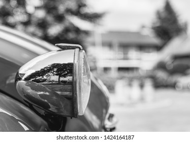 Hengelo / Netherland - June 11 2019 : Black and white photo of the headlight of a Citroën 2cv