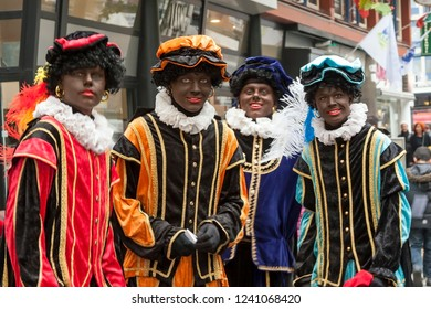 HENGELO, OVERIJSSEL / NETHERLANDS – NOVEMBER 15 2014: Four Black Piets during entry Sinterklaas in city centre.