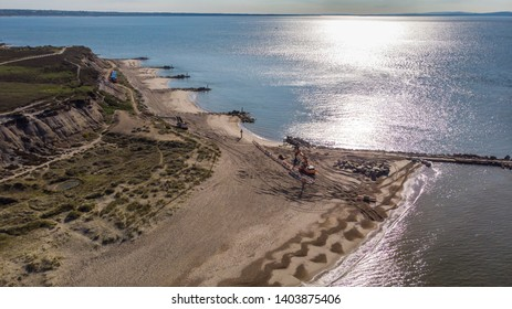 Hengistbury head, Dorset / United Kingdom - May 21, 2019: Aerial view of the work in progress to replace the groyne at Hengistbury Head known as the 'Long Groyne'