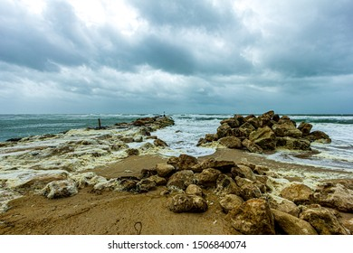 Hengistbury Head, Dorset / United Kingdom - August 10, 2019: A view of the work in progress to replace the groyne at Hengistbury Head known as the 'Long Groyne'