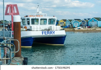 Hengistbury Head, Dorset / United Kingdom - October 01 2015: The Hengistbury  Head ferry arrives after a short sailing from Mudeford Quay.
