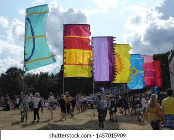Henham Park, Suffolk, UK - July, 21st 2019: Latitude Festival - people walking around, sitting watching music dressed in festival wear