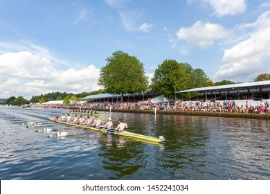 henley on thames, oxfordshire, UK July 4 2019 female rowing eights followed by umpires launch compete in the Henley Royal Regatta