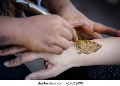 Henna Artist Applying Henna Tatoo On Stock Photo Edit Now