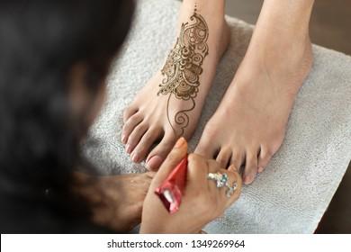 Henna being applied to bride's feet