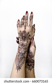 Henna Hands painting art indian holding white background original design One female hand, image of henna pattern. Short manicure nails. Beautiful,Close up professional,wedding design