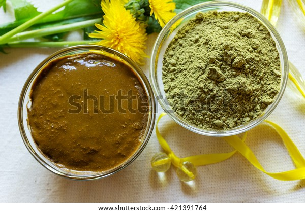 Henna powder. Henna paste. Prepare the henna paste at home. Still life with henna and dandelions. Focus on the powder.