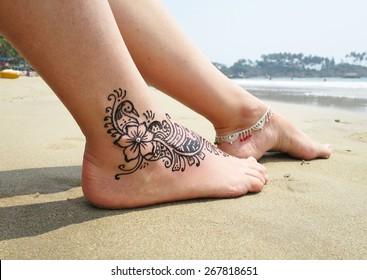 Henna tattoo on the foot. Palolem beach of South Goa, India