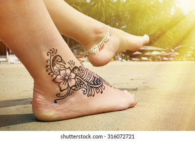 Henna tattoo on the foot. Palolem beach of South Goa, India