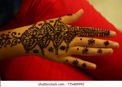 Henna tattoos being put on hands in Fes, Morocco