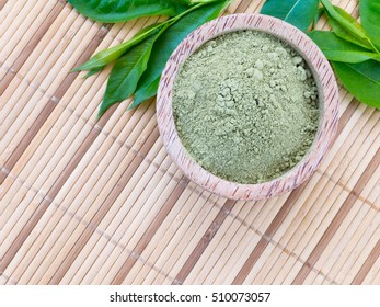 Henna vibrant red natural hair colorant on the bamboo background
