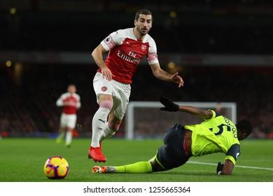 Henrikh Mkhitaryan of Arsenal beats Terence Kongolo of Huddersfield Town - Arsenal v Huddersfield Town, Premier League, Emirates Stadium, London (Holloway) - 8th December 2018