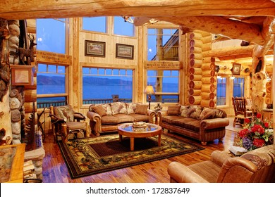 Henry's Lake, Idaho, USA Jul. 28, 2011 The interior of a residential log cabin in the mountains. The cabin is constructed with Eastern red cedar, giving a warm colored light to the interior.